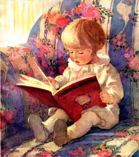 child_reading_in_large_chair